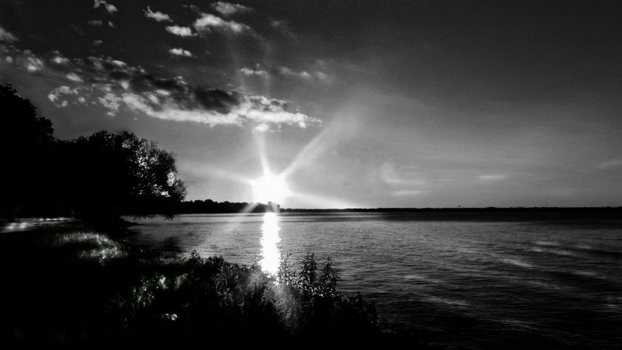 Black and white sunset Cloud - Sky Sky Nature Water Beauty In Nature Outdoors No People Sea Horizon Over Water Power In Nature Bnw Bnw_capturesWisconsinSunset Black And White Sunset