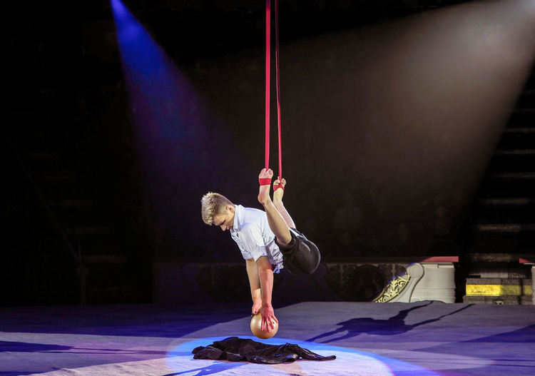 Russia, Moscow. the Nikulin circus, trapeze Child Childhood Children Only Circus Full Length Headwear Healthy Lifestyle Indoors  Moscow Night One Boy Only One Person People Performance Portrait Russia Russian Circus Shorts Skill  Sport Stadium The Nikulin Circus Trapeze Trapeze Artist