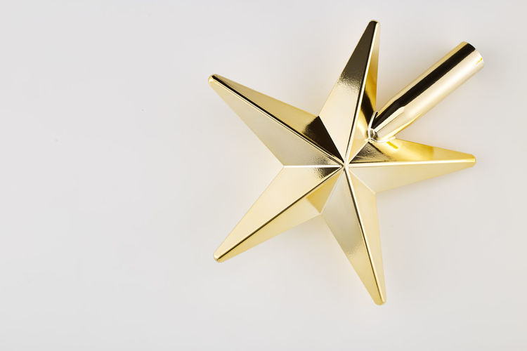 White Background Studio Shot Single Object Shiny No People Indoors  Celebration Christmas Star Shape Holiday Copy Space Paper Gold Colored Decoration Still Life Close-up Event Gift Cut Out Christmas Decoration Silver Colored