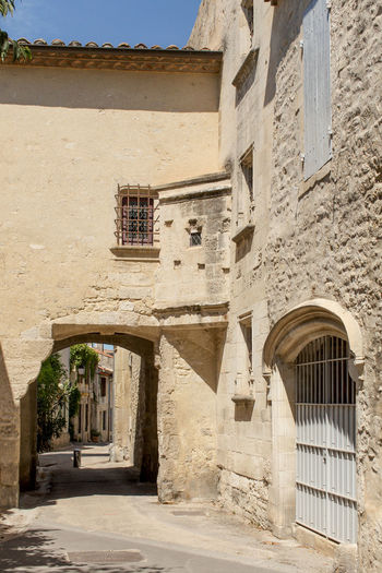 A narrow street at Arles, France Arch Architecture Building Building Exterior Built Structure Day Exterior Footpath Narrow Outdoors The Way Forward Tourism Travel Destinations Window