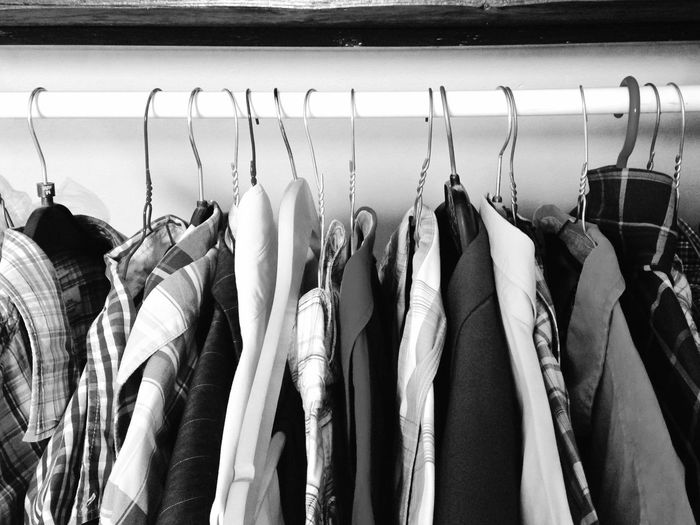 Menswear Clothes Hanging On Rack In Closet