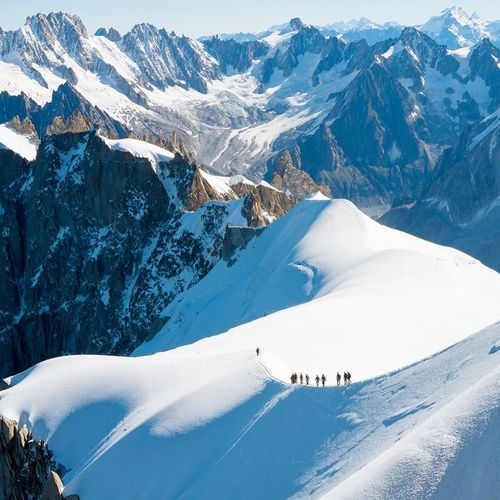 Group of Mountaineers Walking along Ridge in Mont Blanc , Chamonix-Mont-Blanc France . Mountain Snow Travel Sport