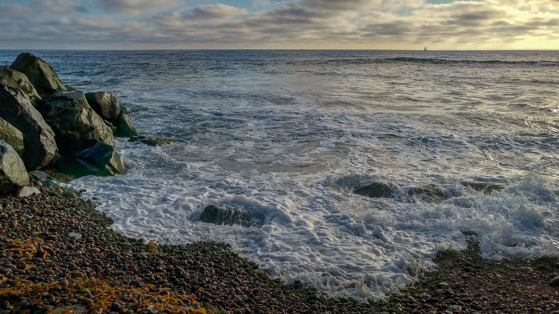 Ocean Beach San Diego Sunset Beach Beauty In Nature Breaking Cloud - Sky Horizon Horizon Over Water Land Motion Nature No People Outdoors Power In Nature Rock Rock - Object Rocky Coastline Scenics - Nature Sea Sky Solid Sport Tranquility Water Wave