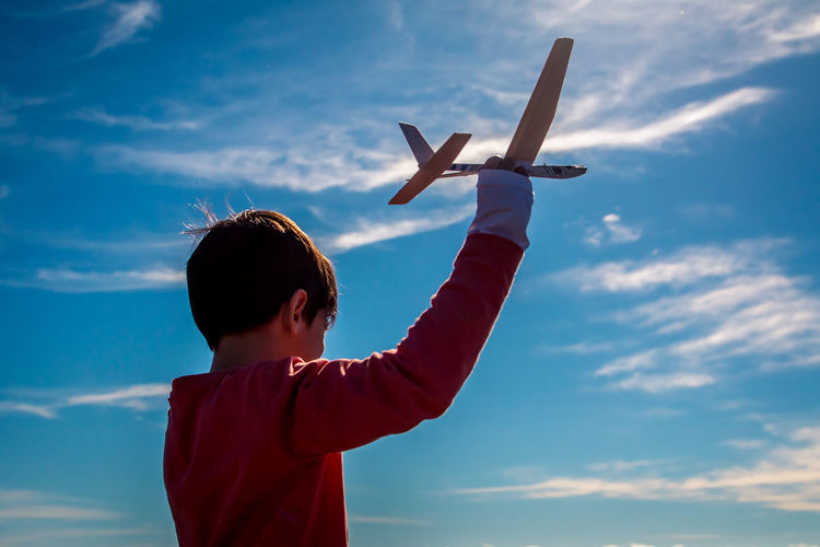 Kid playing with an aeroplane toy Kids Kids Being Kids Kidsphotography Kids Playing Kids Having Fun Playing Playing Boy Child Airplane Childhood Males  Standing Learning Air Vehicle Aspirations Business Finance And Industry Sky The Portraitist - 2019 EyeEm Awards