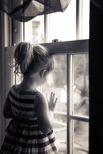 Black And White Black And White Photography Child Childhood Cute Day Elementary Age Girls Home Interior Indoors  Lifestyles Looking Through Window One Person People Pretty Girl Real People Standing Window