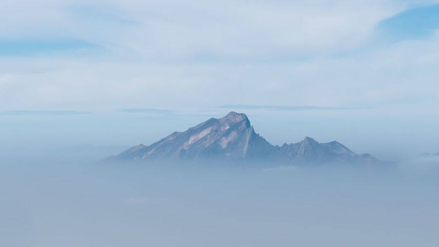 Isolation Mountain Tranquil Scene Scenics - Nature Beauty In Nature Tranquility Sky Cloud - Sky Idyllic Nature Fog Mountain Peak Environment Mountain Range Isolation Above The Clouds Blue Tranquility Scenery