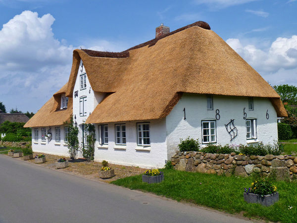 Traditional Frisian thatched cottage in the village of Nebel on the island of Amrum Amrum Frisia Vacations Architecture Building Exterior Built Structure Cloud - Sky Day Flowers Garden Germany House No People Outdoors Rural Scene Sky Street Thatched Cottage Thatched Roof Traditional Travel Destinations Whitewashed