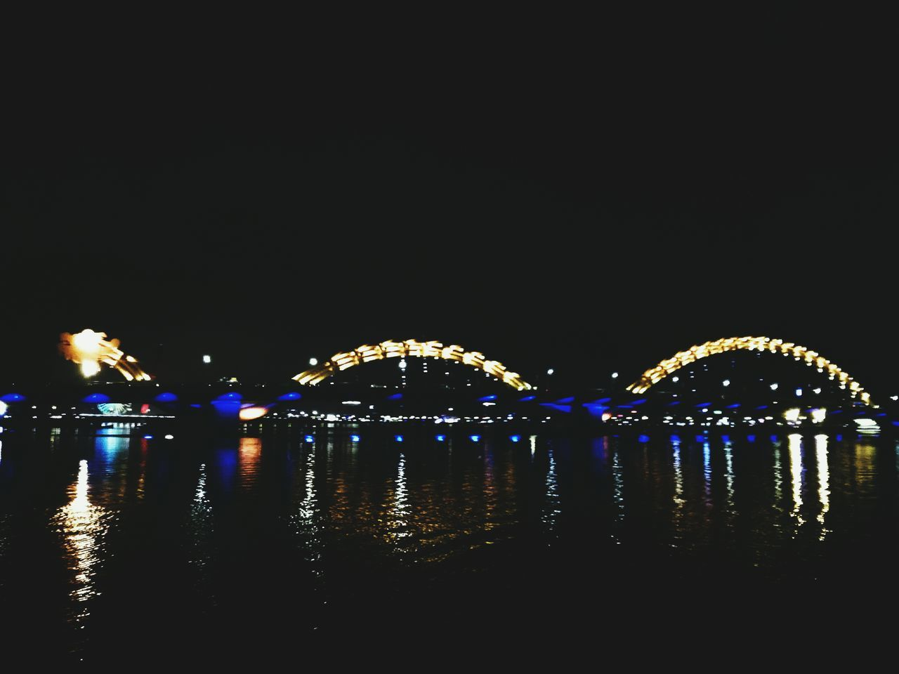 night, illuminated, water, reflection, copy space, outdoors, clear sky, waterfront, no people, sky, architecture, nature, city