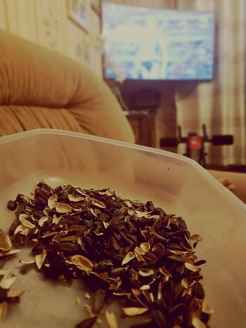 Waching game with sunflower husks Sunflower Husk Watching Waching Stadium Love The Game Mission Lithuania Lifestyle Home Sunflowers Eating In Bed Watching Sport Atlethic Championship Europe Tv Snaks Table Close-up Food And Drink Love The Game