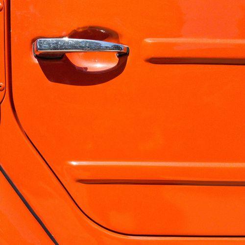 Full Frame Shot Of Orange Car Door