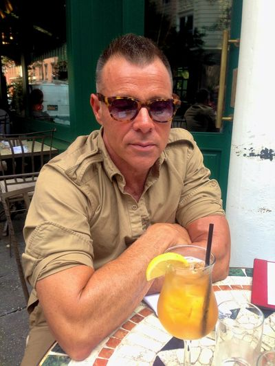 George having iced tea. George Cortina Casual Clothing Day Drink Food Food And Drink Freshness Lifestyles Looking At Camera Mature Adult One Person Outdoors People Portrait Real People Sitting Smiling Sunglasses Table
