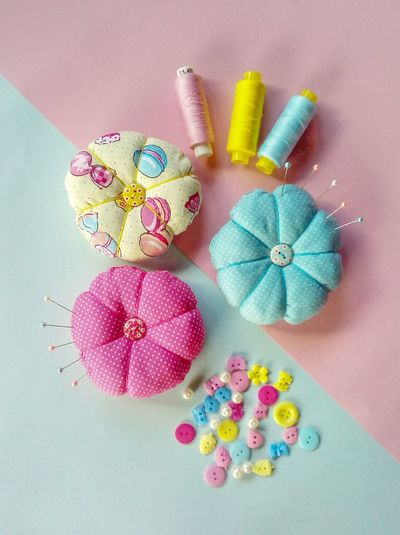 Close-Up Of Pin Cushions On Table