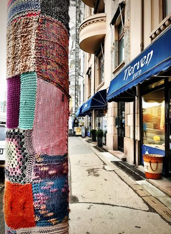 Built Structure Building Exterior Street Architecture City Store Outdoors Day No People Sky Light Post Knitted  Fabric Patchwork Oslo Streetphotography Street Art Oslo Norway Oslo, Norway Street Photography Colors Shotoniphone7 IPhoneography Art Is Everywhere