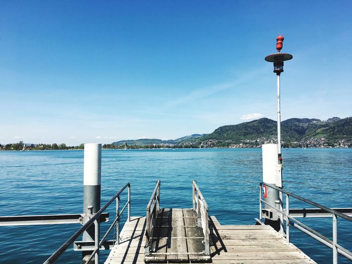 Jetty Water Sky Day Nature Sunlight Clear Sky No People Railing Pier Blue Beauty In Nature Architecture Tranquility Nautical Vessel Scenics - Nature Outdoors Tranquil Scene Wooden Post