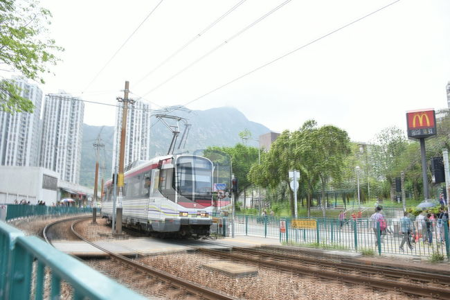Architecture Building Exterior Built Structure Cable City Day Electricity Pylon Hong Kong Image Overlaying Lightrails Mode Of Transport Motion Motion Shot No People Outdoors Overlap Public Transportation Rail Transportation Railroad Track Rails Sky Special Effects Train - Vehicle Transportation Tree