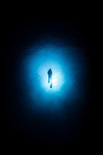 Rota Silhouette One Person Illuminated Full Length Blue Mystery Underwater Back Lit Night Copy Space Dark Spotlight Nature Sport Unrecognizable Person Standing Light - Natural Phenomenon Leisure Activity Lighting Equipment Light At The End Of The Tunnel Capture Tomorrow