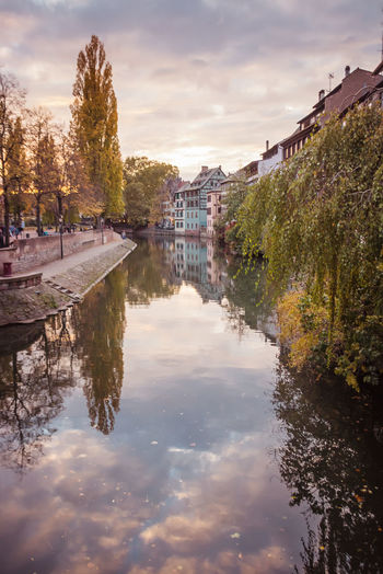 Petite France Half Timbered House Canal Reflection Cloudy Sunset Colors Warm Colors Old Buildings Old City Typical Alsace Water Building Exterior Architecture Sky Tree Built Structure Plant Cloud - Sky Nature Waterfront Building Residential District No People City Outdoors Day Autumn colors