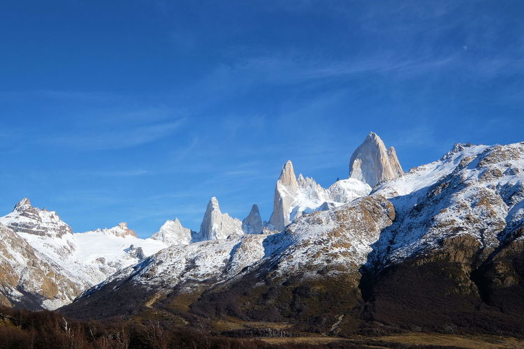 A view of Mount Fitz Roy Mount Fitz Roy Patagonia Argentina Patagonia Silence Lonely Still Hiking Scenics Scenery Landscape Lost in the Landscape Mountain Snow Cold Temperature Mountain Peak Snowcapped Mountain Rock - Object Blue Sky Mountain Range Landscape