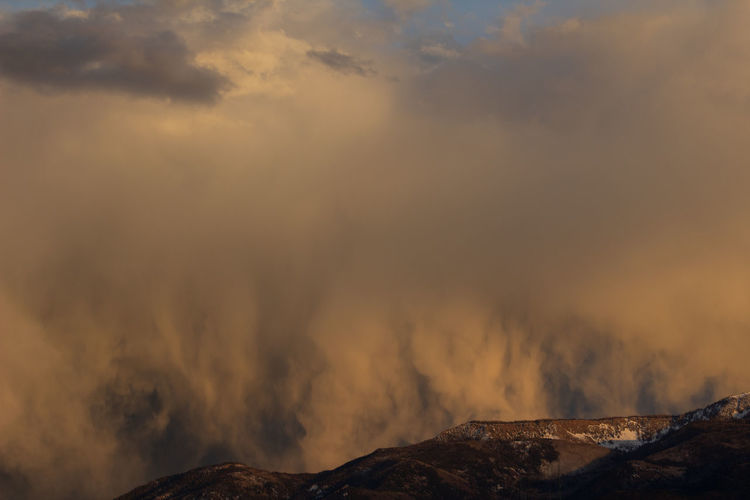 Rainstorm highlighted by a sunset in central utah as it goes over monroe mountain.