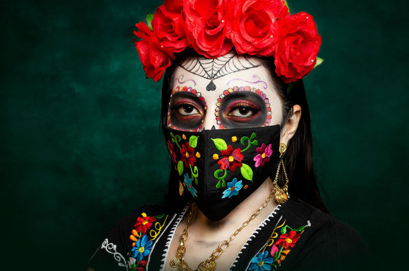 Portrait of woman with red flowers and make-up