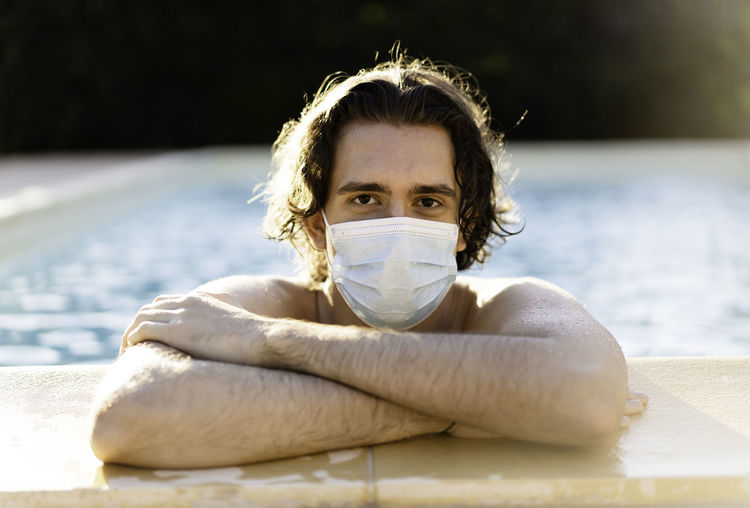 Portrait of young man wearing mask in swimming pool