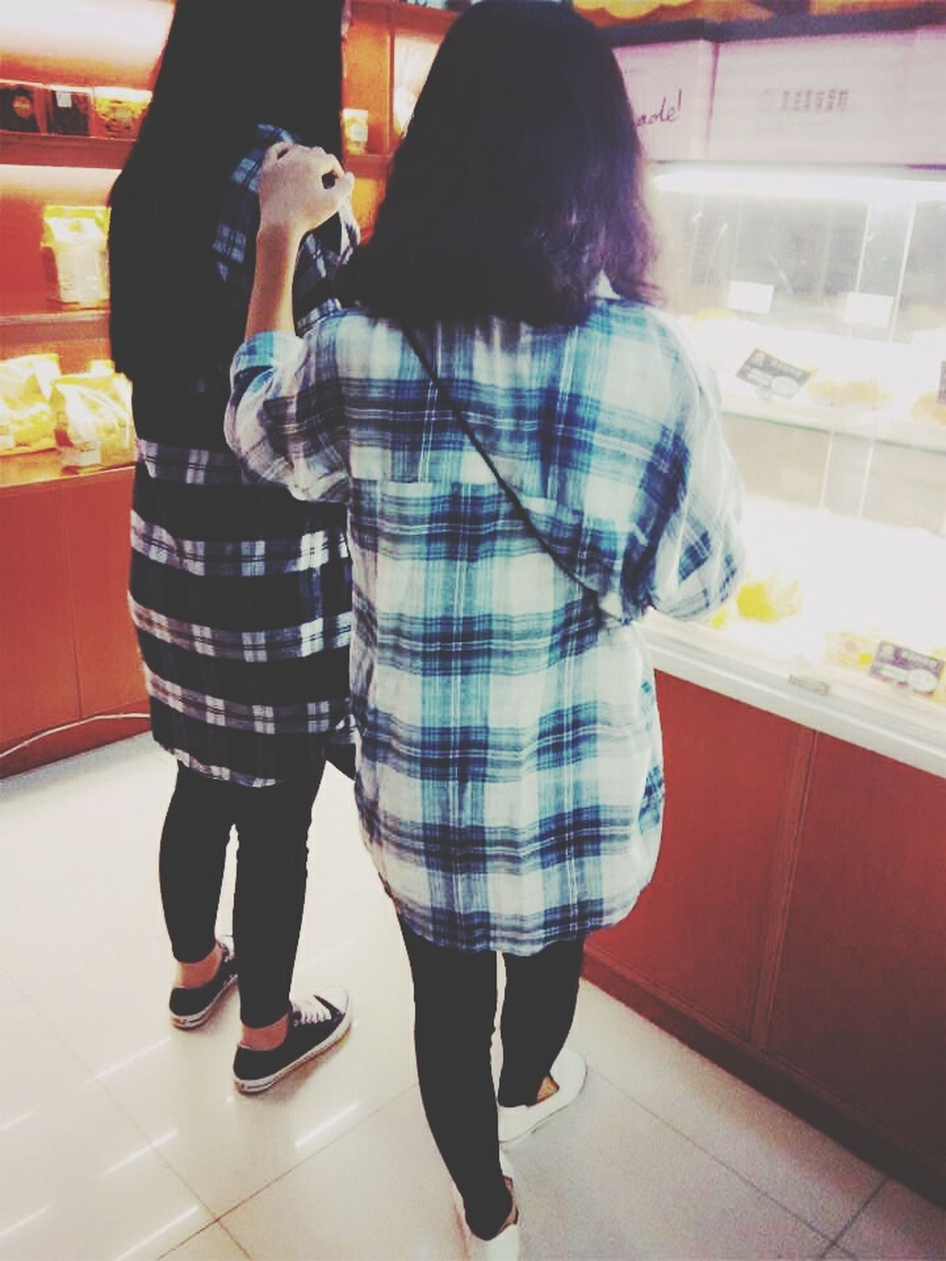 indoors, casual clothing, lifestyles, full length, standing, person, rear view, leisure activity, front view, three quarter length, tiled floor, flooring, walking, side view, holding, fashion, men, store