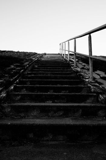 Staircase Architecture The Way Forward Direction Built Structure Clear Sky Railing No People Sky Nature Steps And Staircases Day Outdoors Copy Space Transportation Low Angle View Diminishing Perspective Land Connection Tranquility Surface Level Long