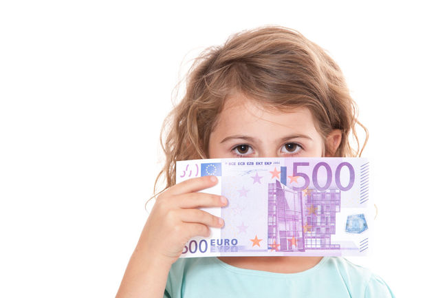 Young girl holding 500 euro note. All on white background. Child Child Care Childhood Curly Hair Euro Euro Notes Girl Girlhood Isolated On White Isolated White Background Kid Money One Person Pocket Money Social Benefit Social Care Studio Shot White Background Young Girl