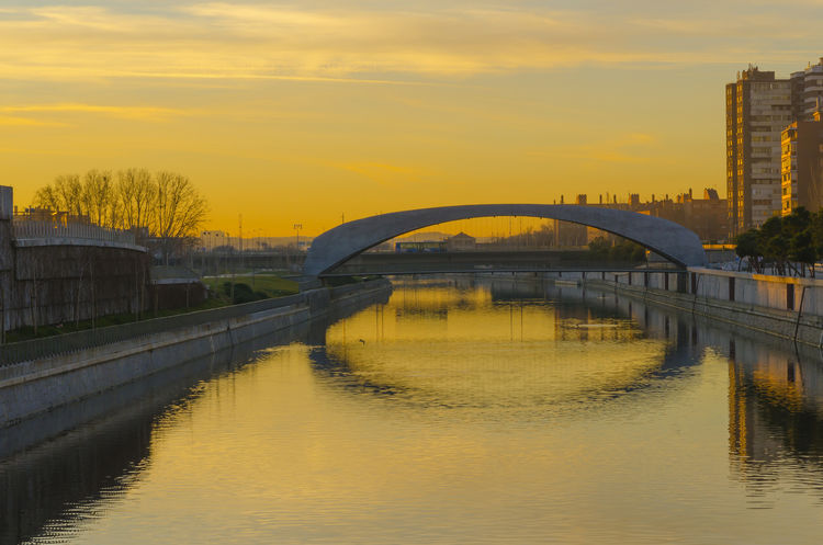 Madrid SPAIN Arch Arch Bridge Arched Architecture Bridge Bridge - Man Made Structure Building Exterior Built Structure City Connection Manzanares Nature No People Orange Color Outdoors Reflection River Sky Sunset Transportation Water Waterfront
