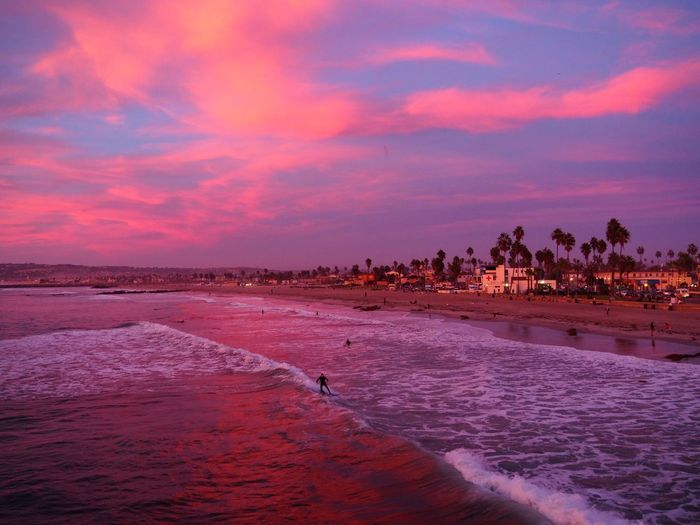 Water Sky Sunset Cloud - Sky Scenics - Nature Beauty In Nature Sea Land Nature Beach Tranquility Tranquil Scene Orange Color No People Outdoors Idyllic Waterfront Sand Purple SoCal Surfing Palm Tree Romantic Sky Ocean Cheesy