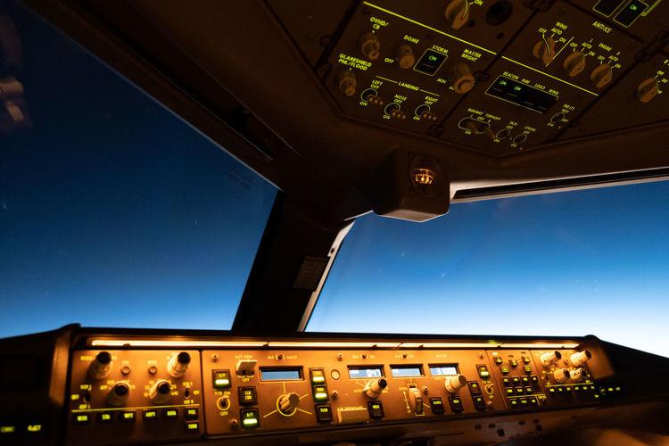 Interior of illuminated airplane cockpit