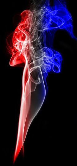 Colorful smoke against black background