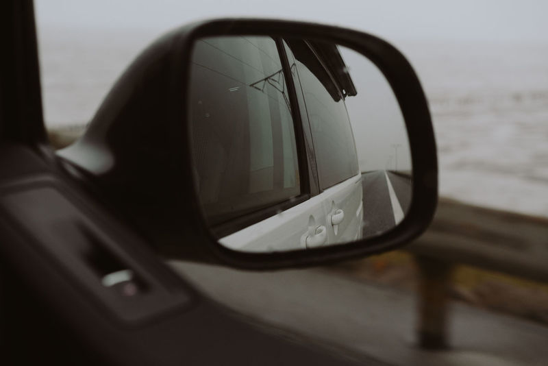 Car Car Interior Close-up Day Focus On Foreground Glass - Material Land Vehicle Mirror Mode Of Transportation Motion Motor Vehicle No People Outdoors Reflection Selective Focus Side-view Mirror Transparent Transportation Vehicle Interior Vehicle Mirror Water