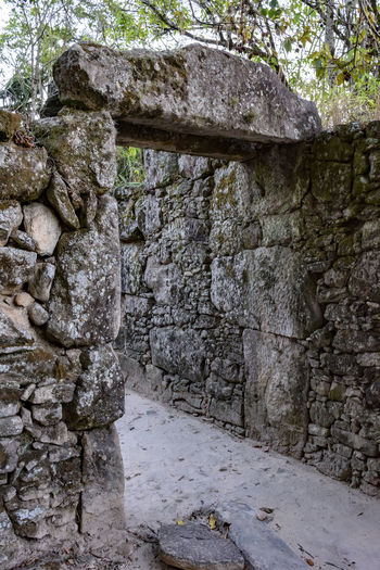 Old ruins of stone farm house built by slaves in Brazil at 18 century 18 Century Ancient Antique Farm Minas Gerais Ruins Aged Architecture Brazilian Built Structure Culture Day Dirty Forest Historic House Nature No People Old Outdoors Quilombo Slaves Solid Stone Wall Wall - Building Feature