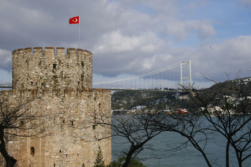towers of the historic 15th century fortress of Rumeli Hisar on the Bosphorus 15th Century Architecture Bosphorus Bridge Building Castle Day Fatih Sultan Mehmet Koprusu Flag Fort Fortress History Istanbul No People Old Ottoman Outdoors Rumeli Hisari Castle Rumeli Hisarı Strait Tower Turkey Turkish Walls Water