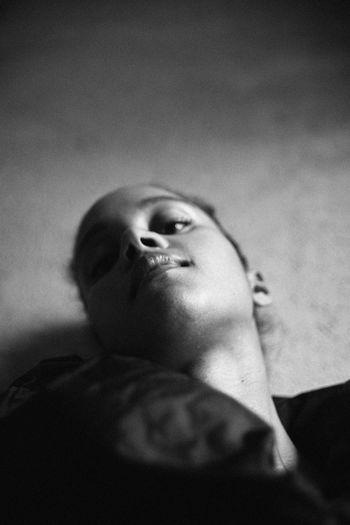 Portrait of smiling girl lying down
