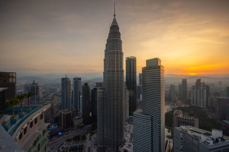 Kuala Lumpur skyline sunrise Building Exterior Built Structure Architecture City Office Building Exterior Building Sky Skyscraper Sunset Cityscape Tower Tall - High Travel Destinations Modern Nature Office Tourism No People Landscape Outdoors Financial District  Spire  Romantic Sky