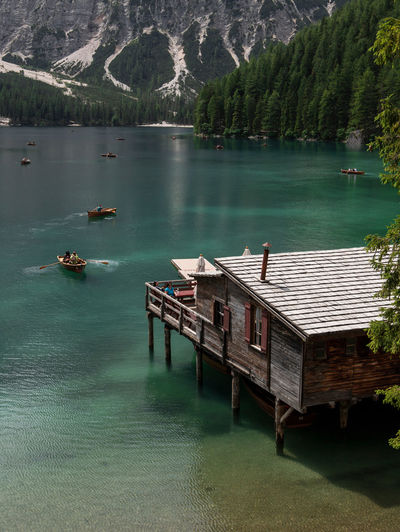 High angle view of stilt house by lake