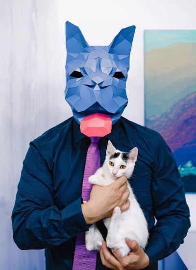 Portrait of man with dog holding umbrella