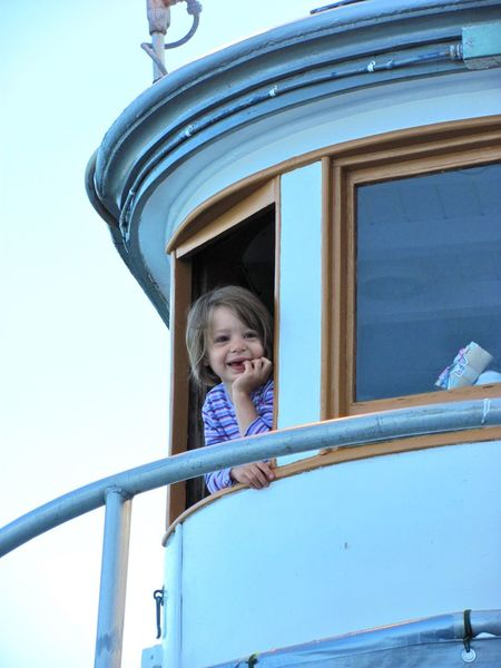 Kate as Captain Alaska Classic Boats Girl Kids Being Kids Old Boat Wheelhouse Window Wooden Boat