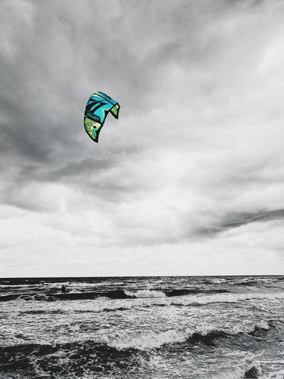 Sea Water Sky Cloud - Sky Horizon Over Water Scenics Nature Beauty In Nature Outdoors Day Tranquility Beach Adventure Kiteboarding No People Wave Extreme Sports Parachute