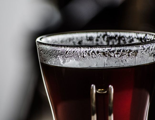 Close-up of cropped black coffee in glass