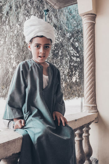traditional clothing at upper egypt Kids The Fashion Photographer - 2018 EyeEm Awards The Portraitist - 2017 EyeEm Awards The Traveler - 2018 EyeEm Awards Traditional Clothing Boys Casual Clothing Child Childhood Clothing Day Front View Innocence Leisure Activity Lifestyles Looking At Camera One Person Outdoors Portrait Real People Seat Sitting Smiling Teenage Boys Teenager Three Quarter Length Turban Young Adult The Portraitist - 2018 EyeEm Awards