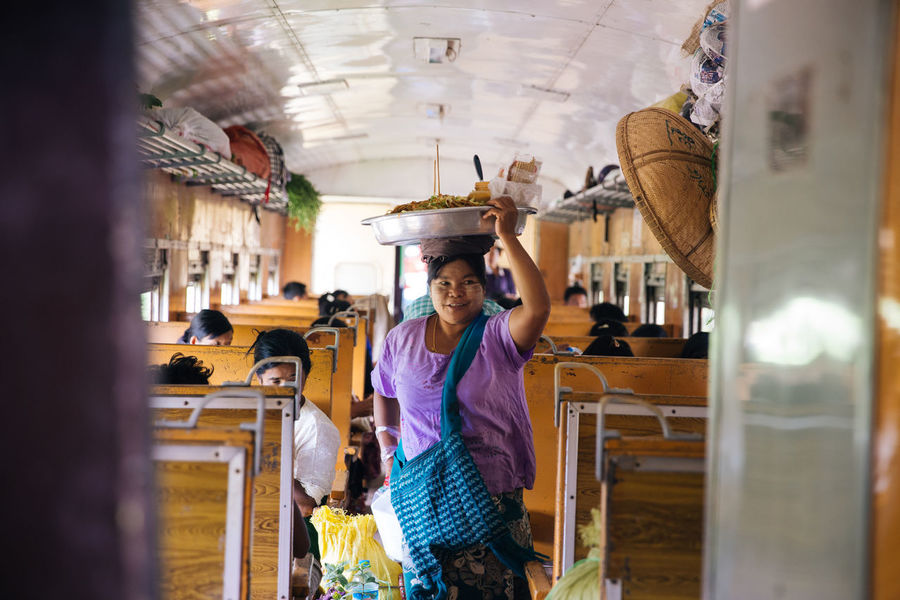 Taking a train does not only offer you a chance to see the country along the journey but also a chance to try the local food. Especially on the long hours of train ride to Hsipaw, you can try local food, snack and drink. While the train's moving, these food sellers go around different carriages with no door and gap in between. It's highly recommend that passenger do not try the act. Asean Burma Burmese Burmese Train Eyeem Myanmar Food Sellers Gohteik Viaduct Myanmar On The Train On The Way Shan State Southeastasia Train Travel Traveling Showcase July Enjoy The New Normal