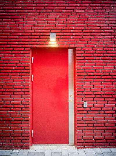 Closed door of red building