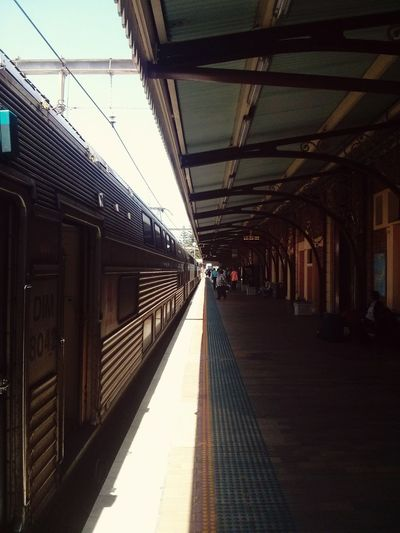 Arriving in Newcastle, Australia. · Train Station City Converging Lines Sunny Day