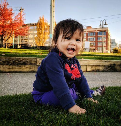 Portrait of smiling boy sitting on grass