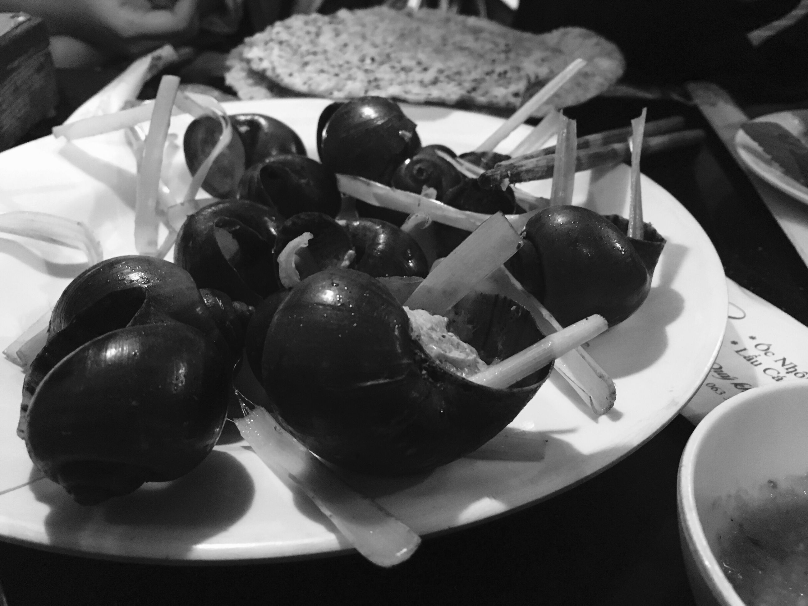 food and drink, food, close-up, black color, freshness, fruit, indoors, chocolate, ready-to-eat, plate, dessert, elevated view, abundance, indulgence, large group of objects, appetizer, focus on foreground, berry, dessert topping, serving size