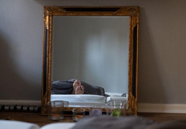 Reflection of person foots seen in mirror