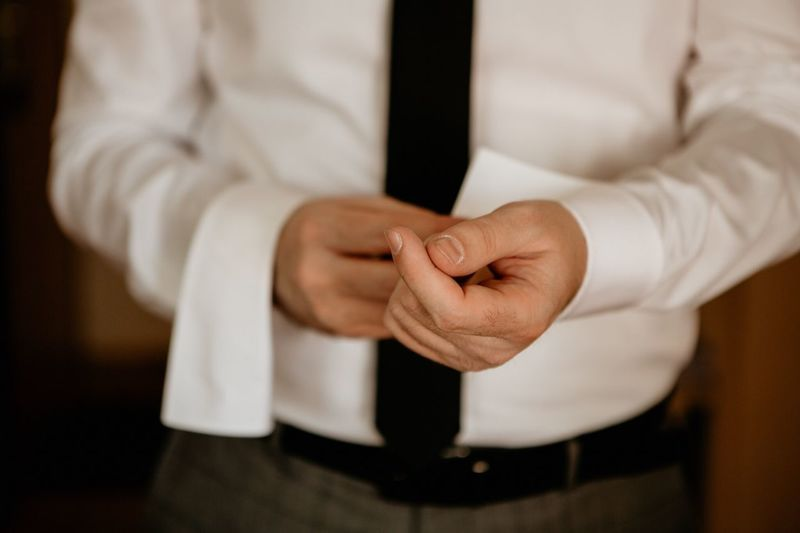 Sleeve links White Shirt Wedding Details Wedding Party Wedding Day Midsection Human Hand Hand One Person Indoors  Human Body Part Real People Clothing Men Front View Focus On Foreground Adult Preparation  Close-up Business Standing Businessman Getting Dressed Button Down Shirt Business Person The Modern Professional EyeEmNewHere
